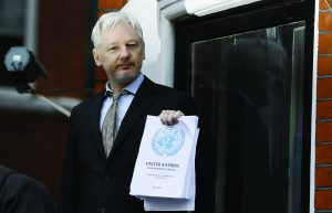 "Wikileaks founder Julian Assange speaks on the balcony of the Ecuadorean Embassy in London, Friday, Feb. 5, 2016. A U.N. human rights panel says Assange, who has been squirreled away inside the Ecuadorean Embassy in London to avoid questioning by Swedish authorities about sexual misconduct allegations, has been ""arbitrarily detained"" by Britain and Sweden since December 2010. The U.N. Working Group on Arbitrary Detention said his detention should end and he should be entitled to compensation. (AP Photo/Kirsty Wigglesworth) ORG XMIT: LKW108"